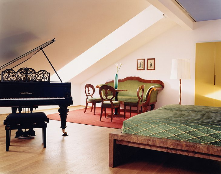 Room with antique furniture and piano