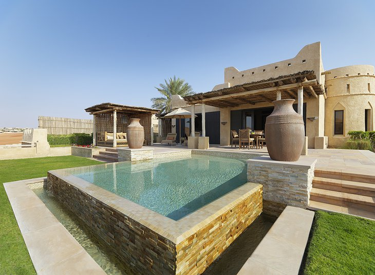 Qasr Al Sarab Desert Resort villa with swimming pool