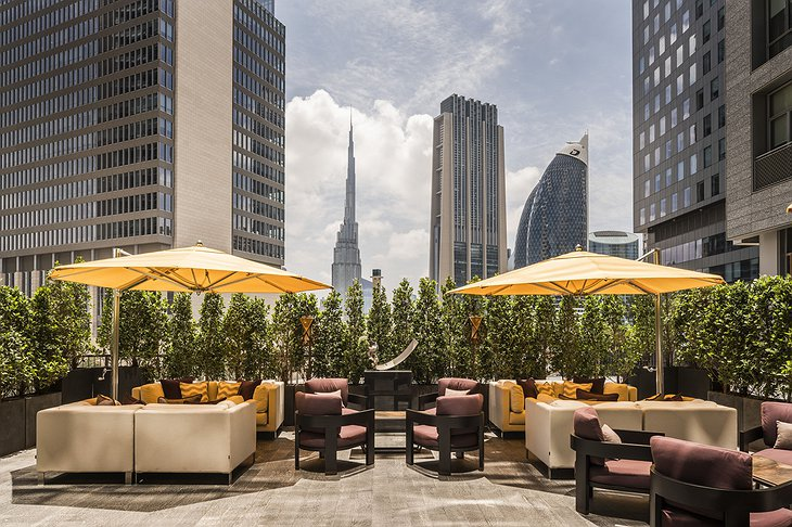 Four Seasons Dubai DIFC rooftop terrace with Burj Khalifa view