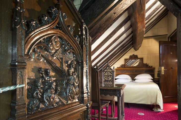 Hotel Saint Merry bedroom with vintage wooden Gothic furniture