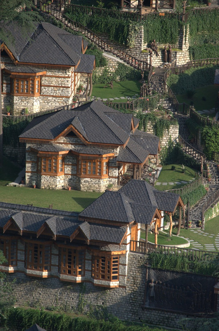 The Himalayan Village Resort traditional rock and wood architecture