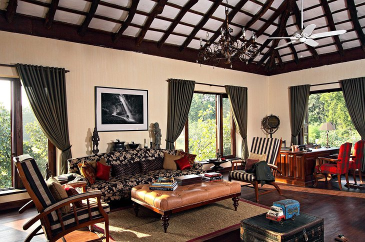 Samode Safari Lodge living room with wooden and leather furniture