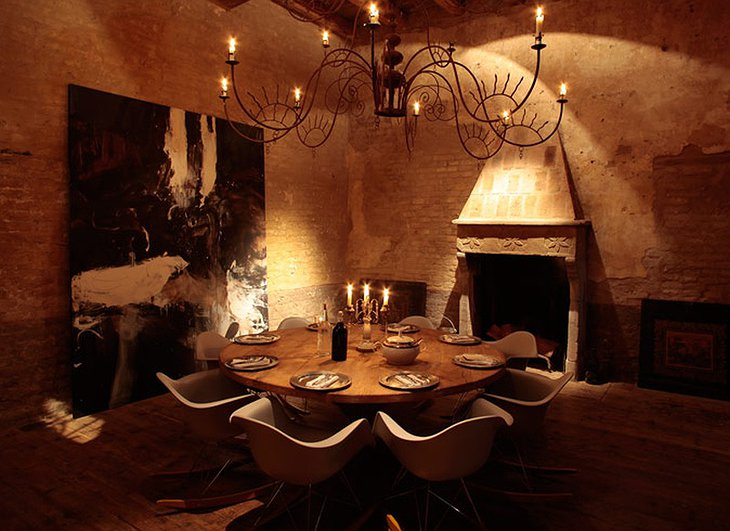 Locanda Rosa Rosae antique chandelier and candle light at the rounded rable