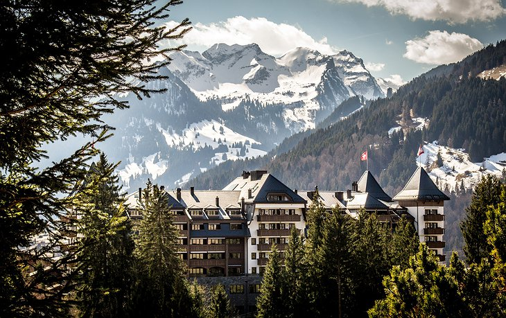 Alpina Gstaad Hotel with Snowy Alps in the Background