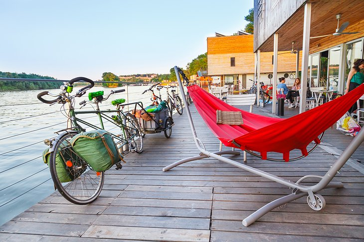 ArkaBarka Floating Hostel terrace with hammock and bikes