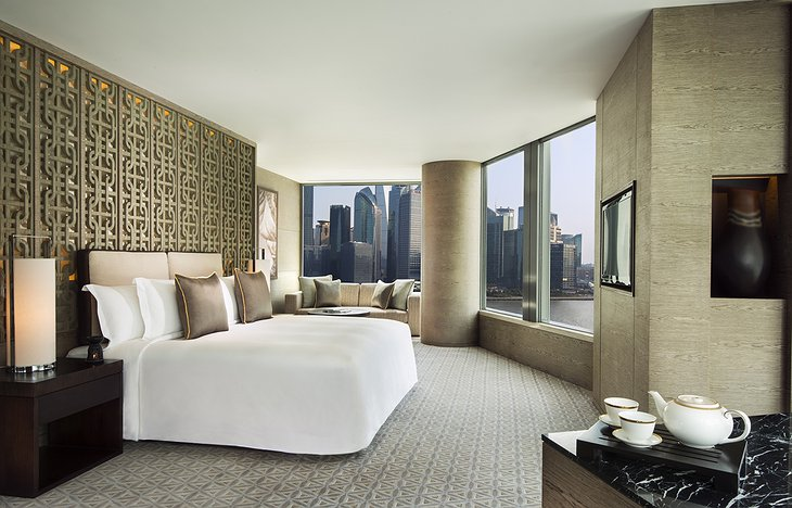 Banyan Tree Shanghai bedroom with city views