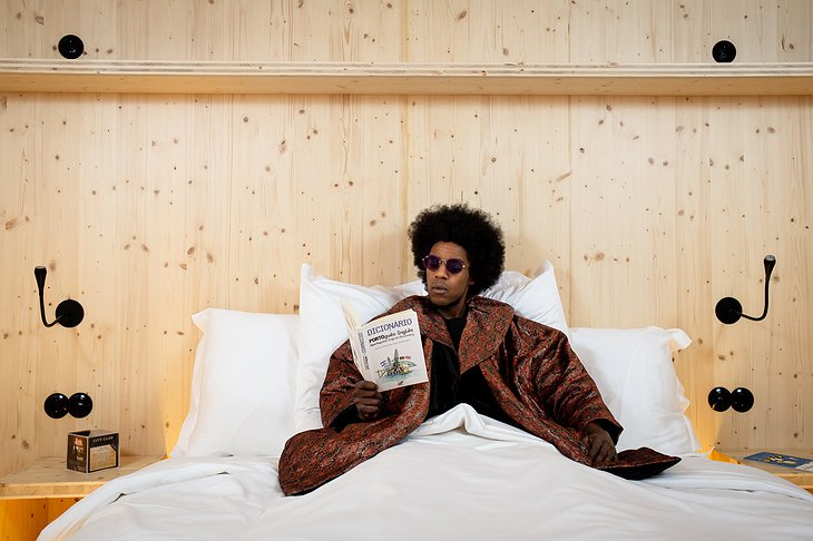Zero Box Lodge Guy Reading in the Bed