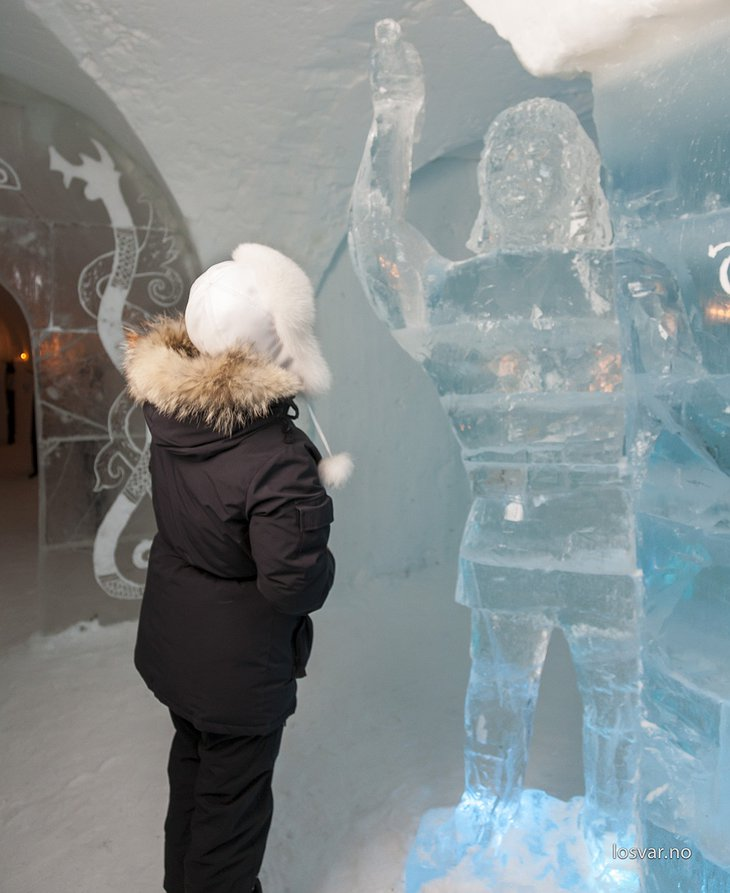 Girl looking at an ice sculpture of a man