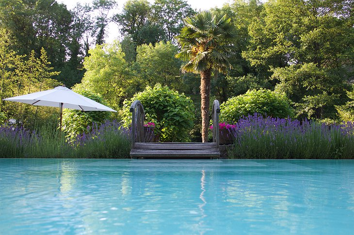 Hotel Le Moulin du Roc pool and the green garden