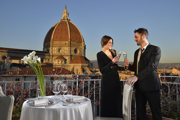 Hotel Brunelleschi rooftop terrace with romantic couple