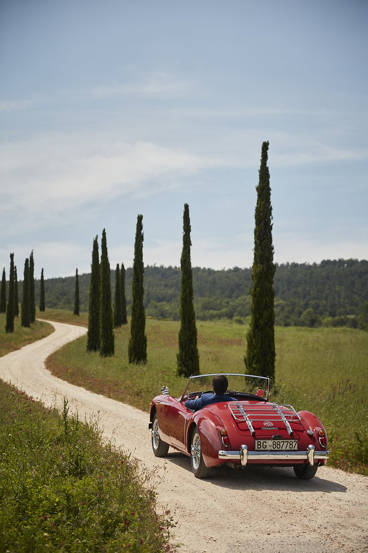 Tuscany Rural Road with a Classic Car