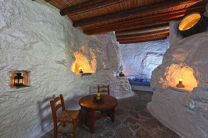 Aspros Potamos Hotel room with white walls and wooden furniture