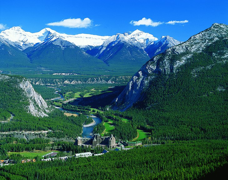 View of Banff nature with mountains and Fairmont Banff Springs Hotel