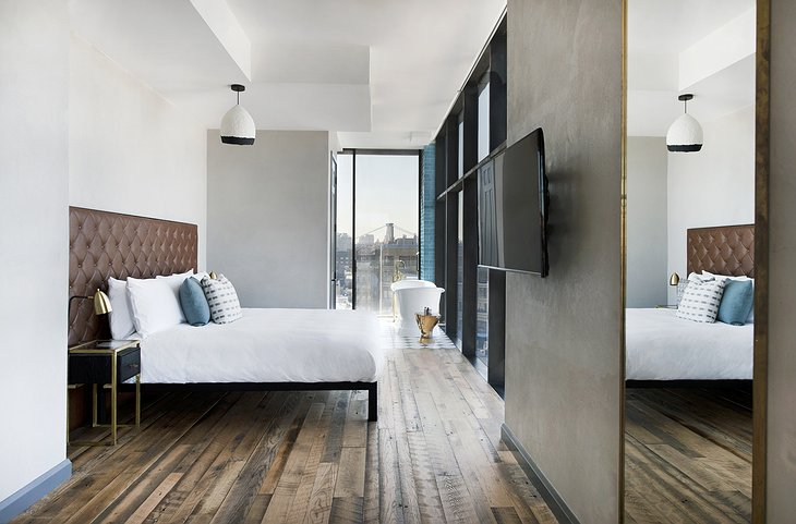 The Williamsburg Hotel bedroom with Brooklyn Bridge view