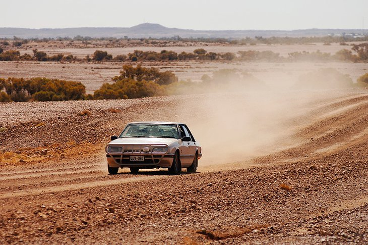Car going in the Australian desert