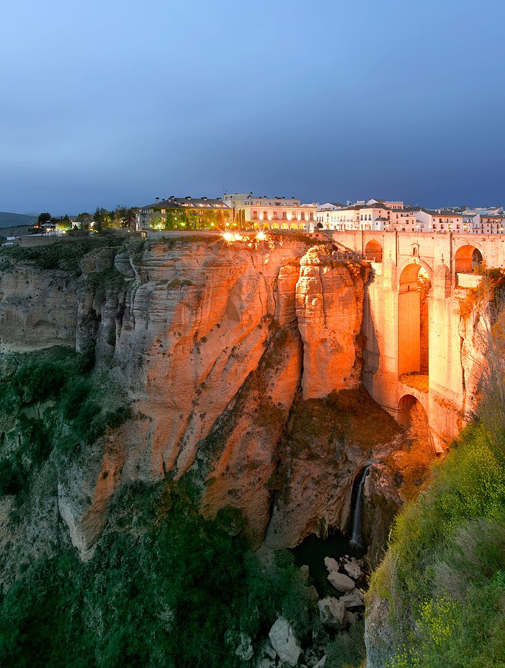 Parador de Ronda above the cliff at night