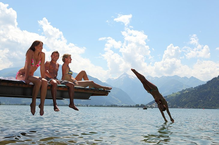 Girl jumping to Lake Zell