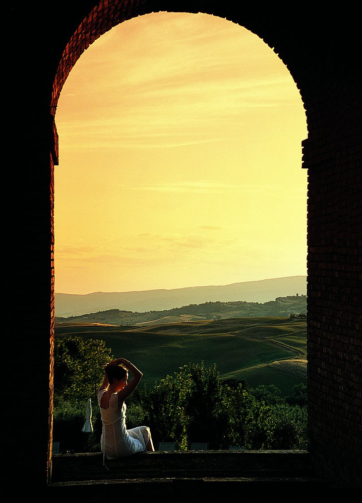Girl sitting in the window to Tuscany