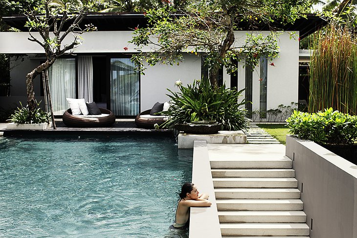 Residence villa with a girl in the pool