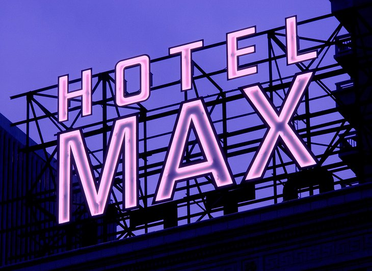 Hotel Max neon-lit sign on top of the building