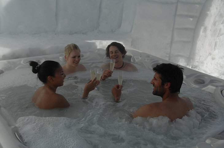 People drinking champagne in the jacuzzi