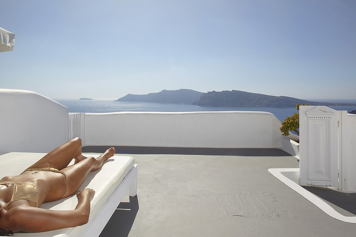 Sunbathing on the terrace of the Kirini Suite