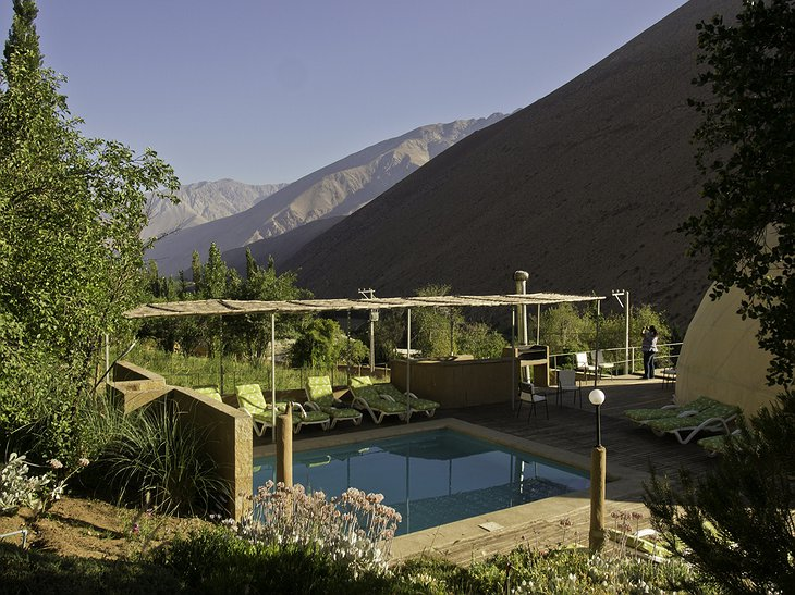 Elqui Domos pool and the mountains in the background