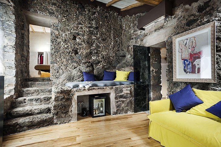 Monaci delle Terre Nere room with stone walls