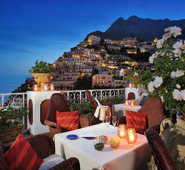 Dining in the evening on the terrace at Le Sirenuse Hotel