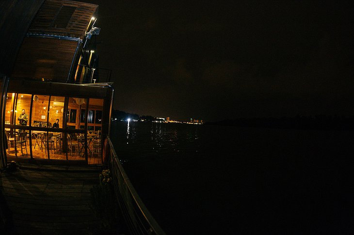 ArkaBarka Floating Hostel at night with river Danube