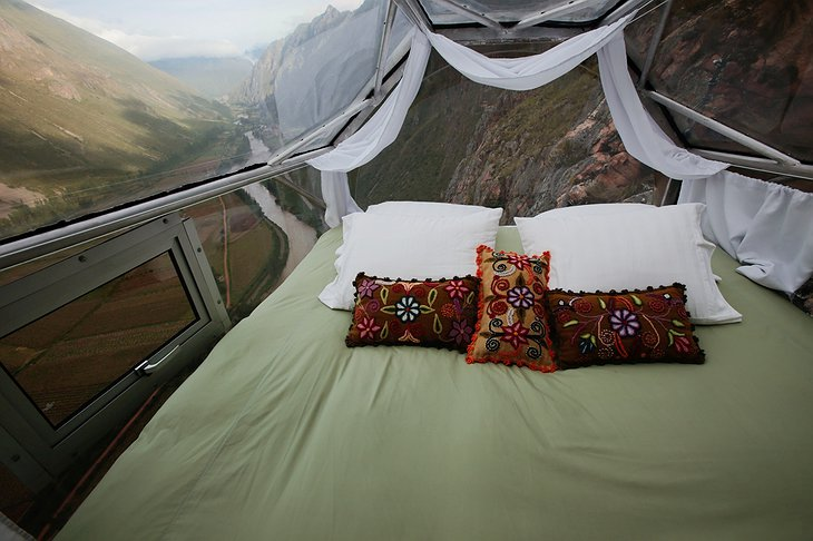 Skylodge Adventure Suites bedroom with panoramic mountain views