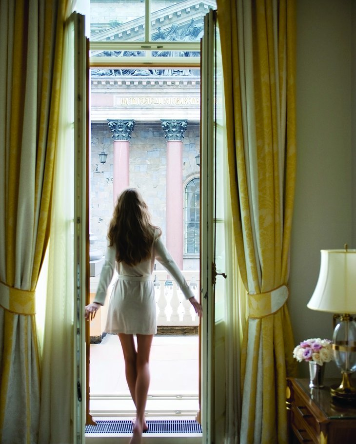 Four Seasons Hotel Lion Palace St. Petersburg with a Russian model girl posing in the room