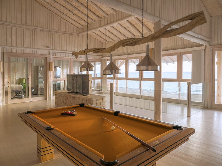 Soneva Jani Maldives 4 bedroom water villa interior with billiard
