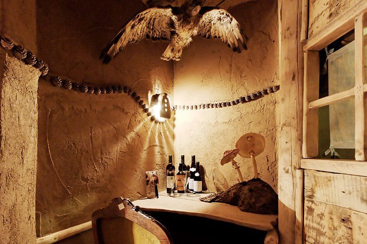 La Balade des Gnomes wine corner with giant mushrooms and dead animals