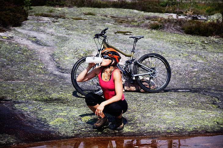 Biker girl drinking fresh water