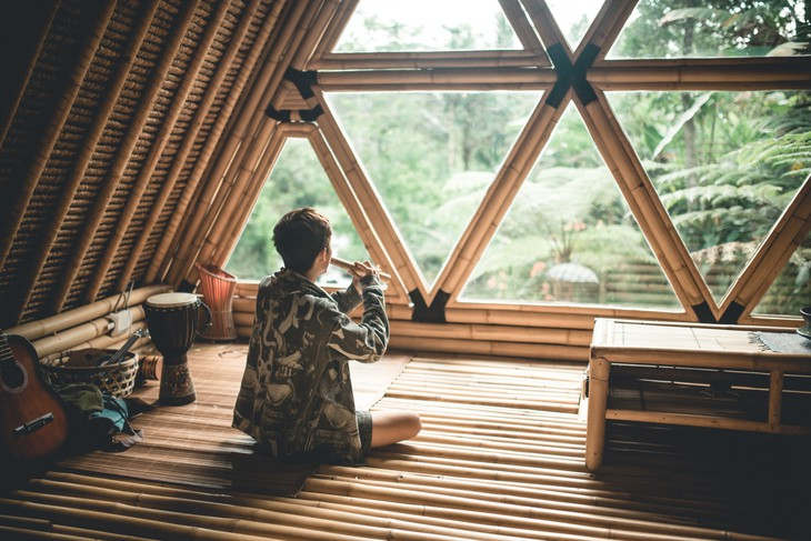 Hideout Bali bamboo house bedroom with triangle windows