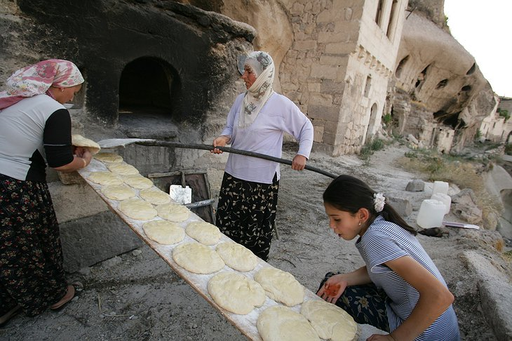 Women baking pita bread