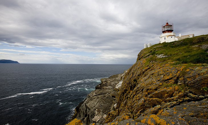Svinoy Lighthouse on top of the cliff