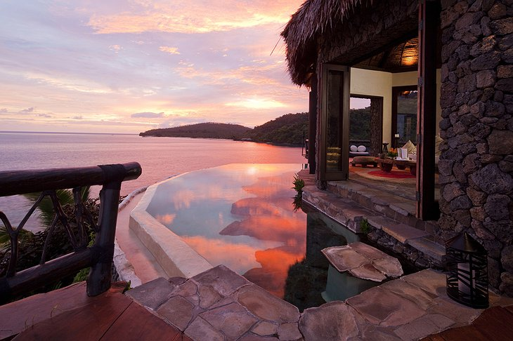 Laucala Island Resort Peninsula Villa pool in the evening