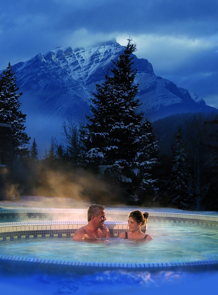 Couple in the steaming hot jacuzzi of Fairmont Banff Springs Hotel