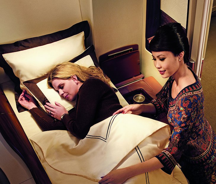 Singapore Airlines stewardess and the passenger in the suite