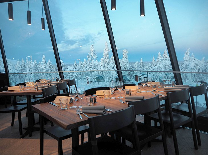 Levin Iglut restaurant with windows on the snowy nature