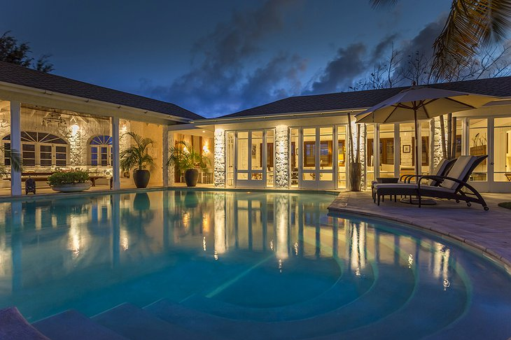 Mustique Island villa at night with pool