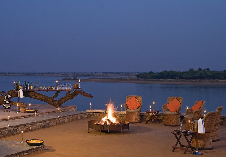 Chhatra Sagar terrace fireplace at night