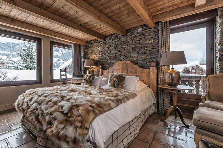 Les Fermes de Marie bedroom with snowy mountain views