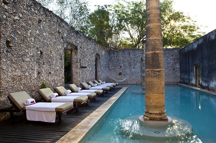 Hacienda Uayamon swimming pool with ancient walls