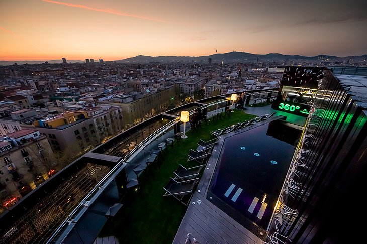 Barceló Raval rooftop terrace at night with pool