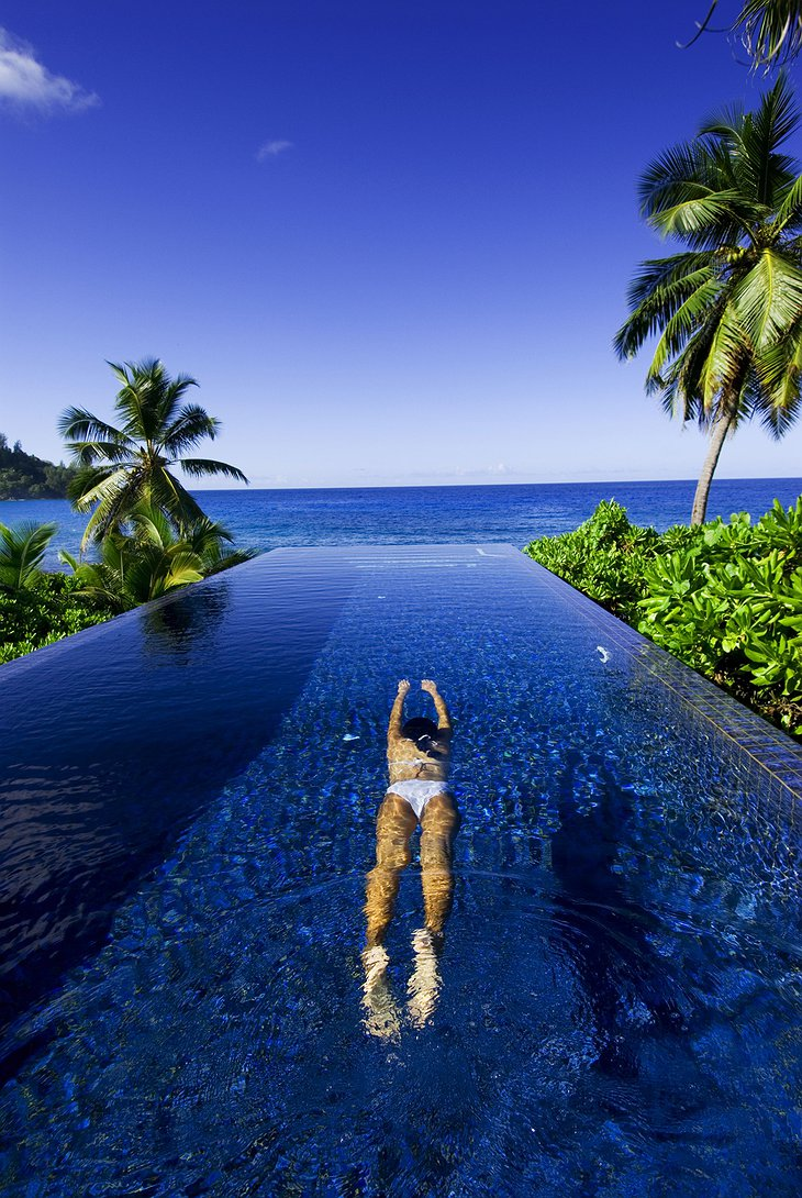 Girl swimming in the infinity pool