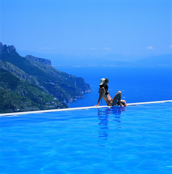 Girl at the edge of the infinity-pool