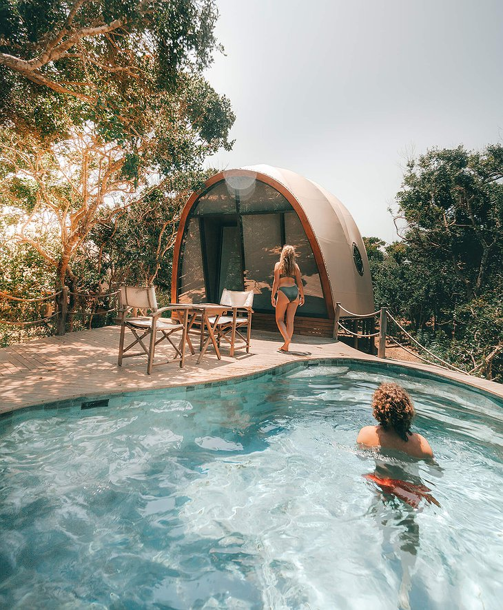 Wild Coast Tented Lodge cocoon tent with pool and a young couple